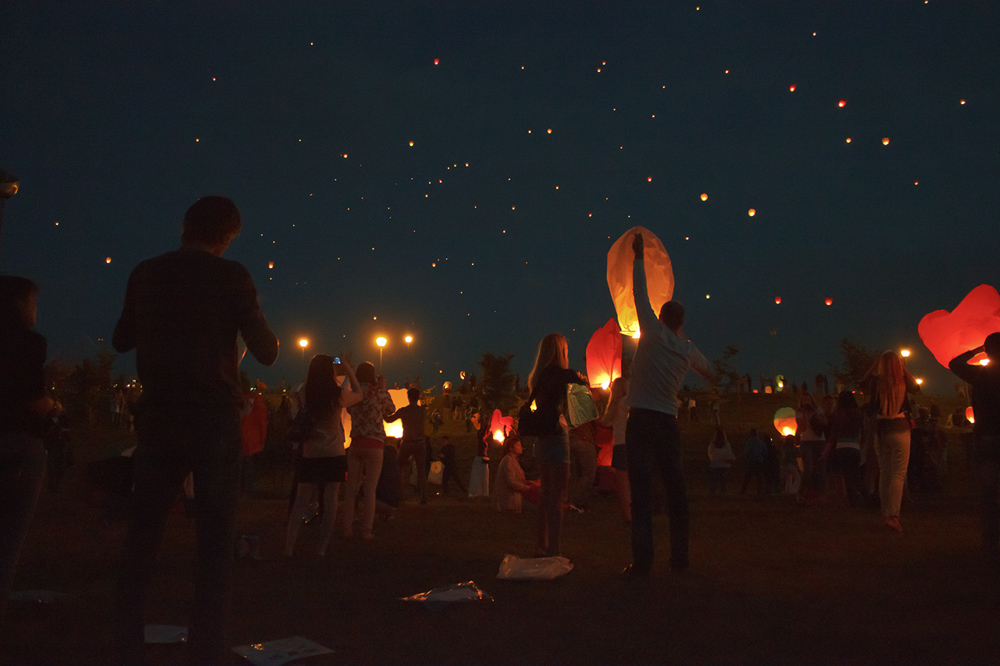 Paper lanterns in the night sky