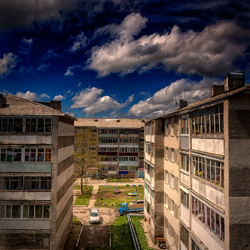 Five-storey buildings in summer day